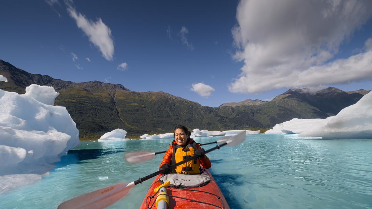 Kayaking through the arctic blue waters of Spencer Glacier in Chugach National Forest