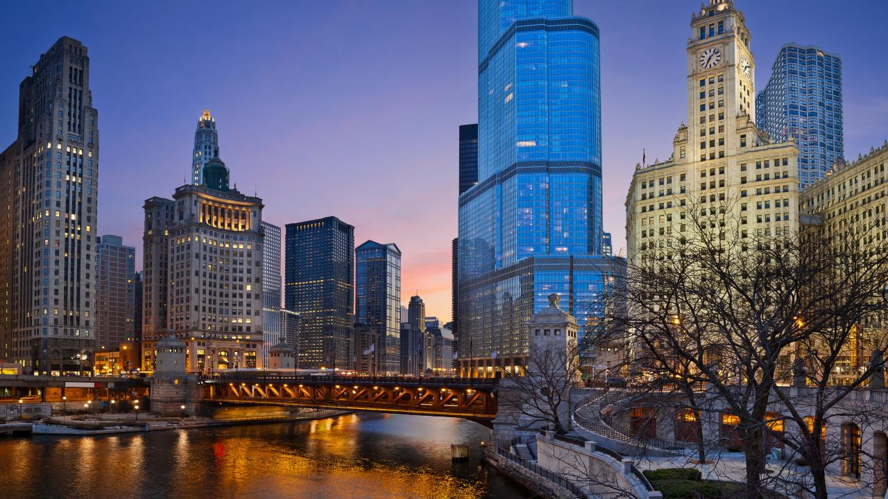 A nighttime view of the Chicago River and the iconic architecture of Chicago, Illinois