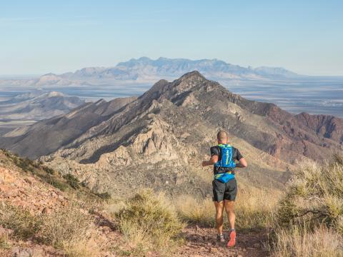 A participant framed by mountain views during the Franklin Mountains Trail Runs