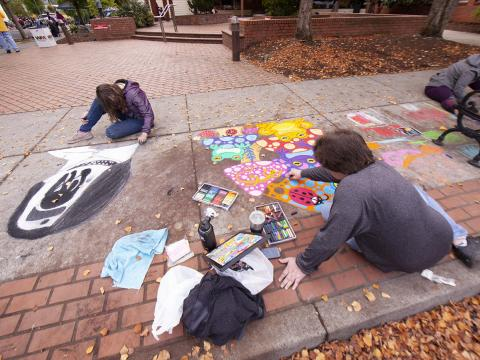 Artists at work during the Sidewalk Chalk Art Festival in Forest Grove, Oregon