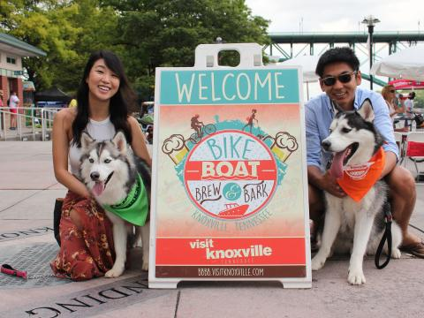 Attendees and their pets at the Bike Boat Brew & Bark event in Knoxville, Tennessee