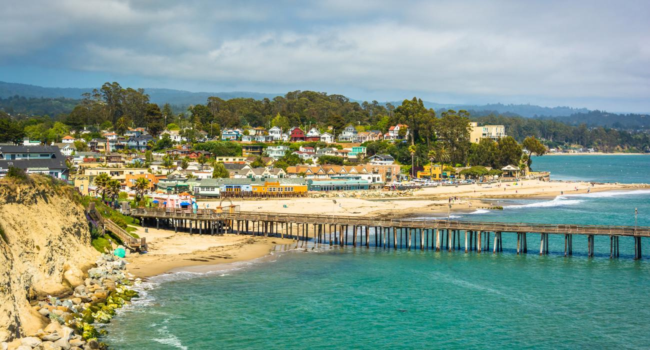 pier and colorful houses at capitola beach