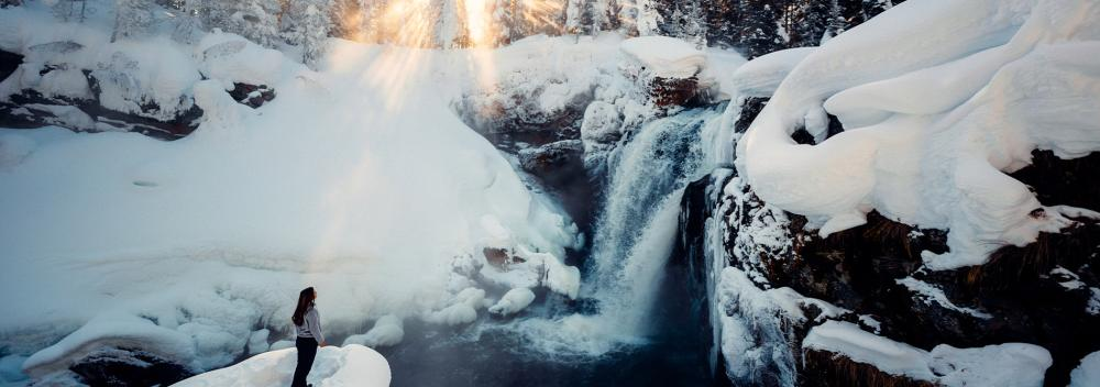 Winter waterfall viewing in Yellowstone National Park, Wyoming