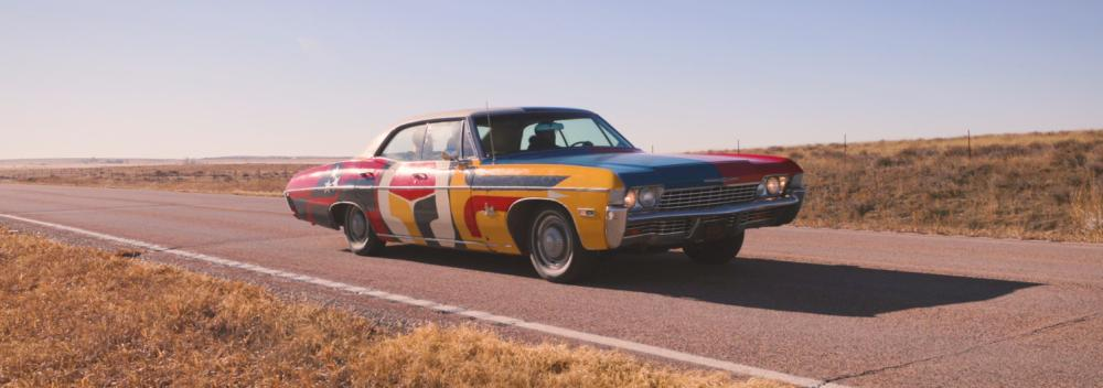 The United Stories mobile studio car on the road in South Dakota